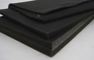 Reticulated foam filter media